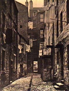 A typical street in the English slums.@late 1800s
