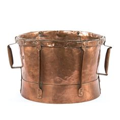 - 19th century copper ferret - Features drum-shaped vessel with side handles - Traditionally used for cooking, measuring grains, carrying water - Alternate uses include a planter or vessel to chill bo