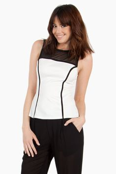 The Sugarlips Sporty Spice Top is a white textured top with a black mesh inset. Features black piping around the front and back. Pair this with black jogger pants for a chic and sporty ensemble. #MyLuluCloset #Sugarlips #Storenvy #Sales #Tops