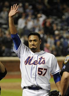 New York Mets starting pitcher Johan Santana (57) waves to fans after throwing a no-hitter against the St. Louis Cardinals in a baseball game on Friday, June 1, 2012, at Citi Field in New York. The Me
