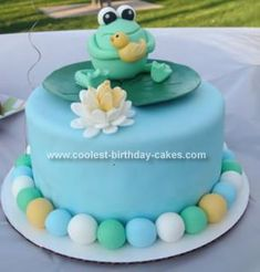 Homemade Baby Shower Frog Cake: This is a Baby Shower Frog Cake I made for my sister's baby shower. The frog, dragon fly, all the decos I sculpted from fondant. I made them about 4 days