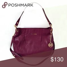 Michael Kors Leather Shoulder Bag Burgundy leather shoulder bag with gold hardware from Michael Kors. Great condition. Inside has MK print with 1 zip pocket, 1 dog clip, and 3 open pockets. Magnetic snap closure. Can be worn crossbody or on shoulder. Michael Kors Bags Shoulder Bags