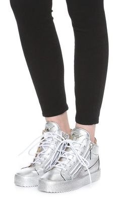 Metallic leather brings statement-making style to these signature double-zip Giuseppe Zanotti sneakers. Swarovski crystals detail the suede side insets, and zips frame the lace-up closure. Tonal rubber sidewall and sole.