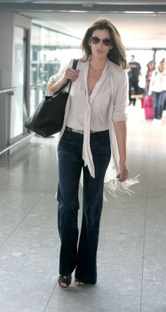 Cindy Crawford  http://www.denimblog.com/wp-content/uploads/2011/06/cindy-crawford-black-orchid.jpg