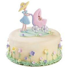 """Ride With Pride baby shower cake. Baby-soft pastels and a charming Mom and Baby Carriage scene in Color Flow are sure to earn """"oohs"""" and """"aahs"""" from every guest at your baby shower!"""