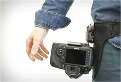 Spider Camera Holster - http://designyoutrust.com/2014/08/spider-camera-holster/