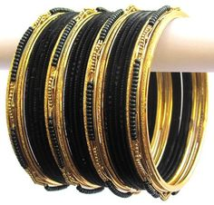Black and Gold Color Indian Belly Dance Costume Bangles Bracelet set of 24 Product Code :Indian Bangles Set 42 The Bangles Set Contains 24 individual Bangles Colors & Design: (As Per Images) Quantity: 1 Bangles Set Base Material : Alloy Metal and Age Group : Adult,Kids Price $USD   7.99