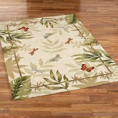 "Butterflies Dragonflies Indoor Outdoor Rugs - These .5"" thick, polypropylene area rugs are hand-hooked in China. The solid cream background is accented with a border and scattered tropical leaves, butterflies, and dragonflies; Spot clean or spray clean with a garden hose. Accent colors include light cream, parchment, taupe, sand, light chocolate, moss, jungle green, slate blue, sterling blue, amber, vermillion, and ruby."