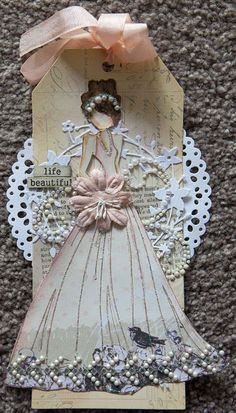 Love the doily in back; can also cut a slit and slip tag through