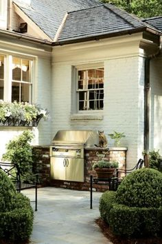 SIMPLE BRICK-ENCLOSED GRILL. Who says an outdoor kitchen has to be overstated? This grill (albeit a nice one) is subtly enclosed within brick with just enough countertop space. I'd venture to say this is classier than an all-out, bells and whistles outdoor set-up.