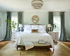 """Minnette designed the master bedroom to be a respite from the noise of everyday life, and chose a color palette of """"watery"""" blues to create that restful atmosphere. A touch of Scalamandré tiger print pops against crisp and classic Matouk linens."""