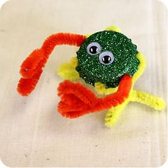 Bottle Cap Crafts--Monsters using bottle caps, googly eyes and pipe cleaners