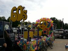 60's theme parade float complete with to 60's bicycles