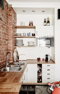 Exposed brick kitchen.