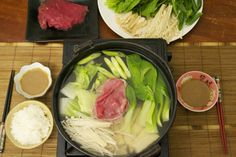 Shabu-shabu Recipe - one of my favorite meals! you can get creative and use fish, chicken, shrimp, crabsticks, wontons, fishcakes and all sorts of fresh veggies like carrots and radishes. change up the stock for different base flavors!