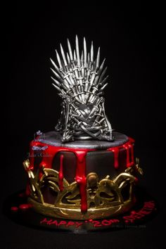 Game of Thrones - Mark II - This is the second GoT inspired cake I have made now. This time I added the crown around the bottom for something different. The throne is handmade with sugar swords and the crown is all handcut and handpainted gold