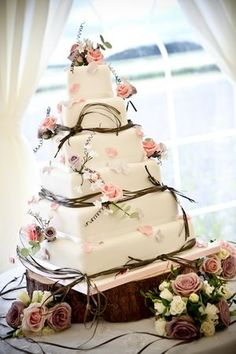 square cake with flowers and ribbon