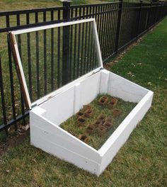 Recycle an Old Window into a Mini Greenhouse.  Would like to make this to put tall pots in.