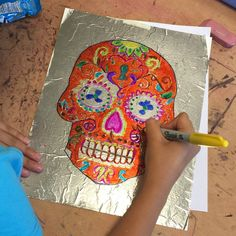 Day of the Dead Sharpie Art. Trace a skull drawing onto a sheet of foil that is glued to heavy white paper. Sit back and color with Sharpies for an amazing work of art. #Sharpieart #dayofthedead