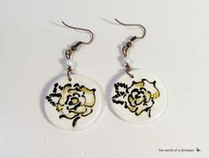 Handmade, hand painted ceramic earrings.  See more here: https://www.facebook.com/theworldofadinosaur