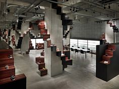 neat stair way displays built around existing posts/beams at Puma House by Nendo, Tokyo store design