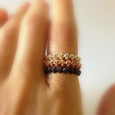 Love them all! Etsy listing at https://www.etsy.com/listing/176360390/tiny-skull-stack-rings-black-gold-white