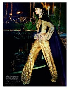 Turning up the shine factor, Gigi Hadid takes a walk in Zuhair Murad look