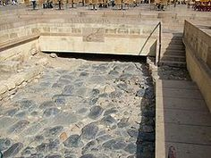 Section of the Via Domitia discovered in front of the Town Hall Narbonne & available for viewing and walking on by the public.