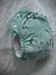 Super cute cloth diaper pattern with instructions on hassle free laundering? Man, I would love to not have to buy diapers ever. Plus, these look way cuter than that plastic crap that never biodegrades in a landfill somewhere...