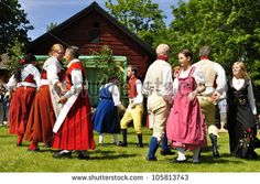 TORSTUNA, SWEDEN - JUNE 22: Unidentified people in folklore ensemble in traditional folk costume.The official name is midsummer event and org are hembygd Torstuna on June 22, 2012 in Torstuna Sweden