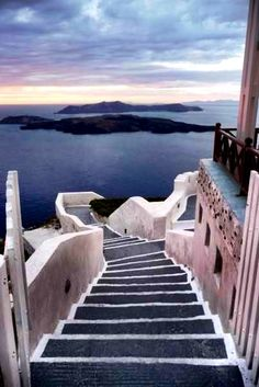 Santorini volcano, Santorini, Greece, they walked slowly down the steps hand in hand, their eyes drinking in the dream they were amidst.  When they came to the beach he pretended to bend down to pick up a shell so that she would be a few steps in front of him. She stopped and turned towards him, what did you find she asked.  Nothing he said, I was just looking at your foot prints in the sand and how they end at you.  She smiled and softly uttered shush, and motioned for him to join her.