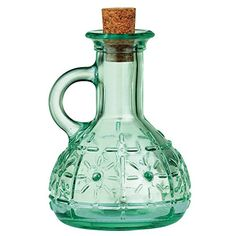 Serve oil and vinegar with elegance using this Country Home Olivia oil cruet from Bormioli Rocco. Made of beautiful blue-green tinted glass, this elegant bottle features a textured starburst design. Glass Bottle With Stopper, Glass Bottles With Corks, Green Glass Bottles, Olivia Oil, Tapas, History Of Glass, Olive Oil Dispenser, Olive Oil And Vinegar, Olive Oil Bottles