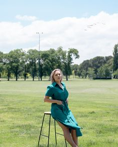 A rayon, button-down dress with a collared neckline, 2 front pockets, mid-calf length, ribbon belt, and thigh-high side slits #effortless #style #australia #teal #buttondown Ribbon Belt, Deep Teal, Button Down Dress, Thigh Highs, Calves, Collars, Thighs, Neckline, Australia