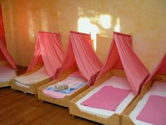 Wonderful Waldorf preschool beds. How much fun would it be to have your own bed at school and that cool canopy over it???