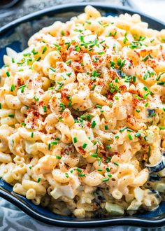 This Deviled Egg Macaroni Salad tastes just like deviled eggs, super creamy and loaded with celery, olives, pickles and red onion. Quick and delicious! www.jocooks.com #macaronisalad