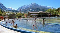 Folks enjoy the Ouray Hot Springs Pool beneath snowcapped peaks