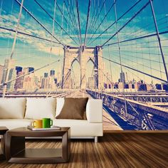 """A New York icon, the Brooklyn Bridge is a timeless landmark. At its opening in 1883, it was the longest suspension bridge in the world, and it held that record for a very long time. This adhesive and removal wall mural decal is an easy and worry-free way to commemorate this incredible structure and the city it represents. Available in 3 sizes: 5 panels (100 inches wide), 7 panels (140 inches wide) & 9 panels (180 inches wide) Each panel is 20"""" wide by 100"""" tall. Please Note: The mural image…"""