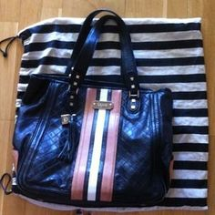 I just discovered this while shopping on Poshmark: L.a.m.b large Tote bag. Check it out!  Size: OS