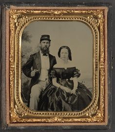 "Unidentified soldier from a Charleston militia unit in kepi with letter ""M"" and unidentified woman, ca. 1862 