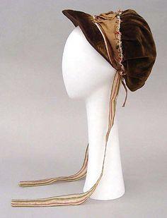 Brown velvet and silk cap ca. 1810 - in the Metropolitan Museum of Art costume collections.