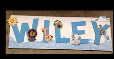This wall hanging was created for a Noah's Ark nursery.  The background is stretcher bars with painted burlap over them. The letters are painted craft board letters from Micheal's.  I didn't get wood because of the weight.  The animals are painted wooden cutouts.  It turned out really cute!