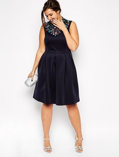 Love the embellished neckline on this flirty dress.