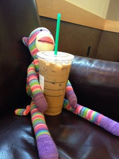 Pier 1 Rainbow Sock Monkey cools off with an iced coffee