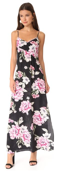 cross it off maxi dress by Yumi Kim. A floral print Yumi Kim slip dress cut from soft silk with a diagonal front seam. Adjustable shoulder straps and elas...