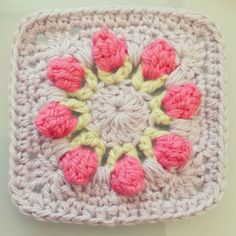 Rose Bud Granny Square. I am completely in love with this pattern that I found here on Pinterest; it was quite challenging for a beginner like me but I did it! Link to pattern: http://dearestdebi.com/flower-bud-granny-square #crochet #pattern #grannysquare #rosebuds