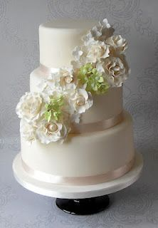 Fondant- The Wedding Cake Blog: Floral Cascade Wedding Cakes bridal wedding cake Repinned by Moments Photography www.MomentPho.com