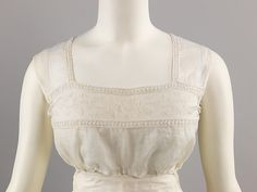 Tucker (image 1) | French | 1820 | cotton | Brooklyn Museum Costume Collection at The Metropolitan Museum of Art | Accession Number: 2009.300.3891 | Precursor of the modern brassiere, a tucker was worn as a modesty piece under sheer cotton empire line dresses .