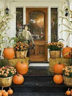 Traditional favorites like pumpkins and bales of hay, layered with mums in rustic baskets. (Photo: HGTV)