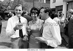 Garden Party at home of Graham Hill, Motor Racing Driver, to celebrate his successful return from America, where he competed in and won the Indianapolis 500 (held on 30th May) at his first attempt, pictured at home with wife Bette Hill and Jim Clark, who - Stock Image