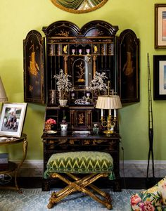 Black and gold lacquered Chinoiserie secretary, chartreuse walls, a shimmering pale blue and white Stark rug, and a teensy hint of a chintz club chair make for the perfect living room vignette, as far as I'm concerned, by the kindly and fabulous uncle I never had, Mario Buatta.